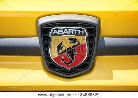 TURIN, ITALY - JUNE 9, 2016: Fiat Abarth logo on a yellow car body
