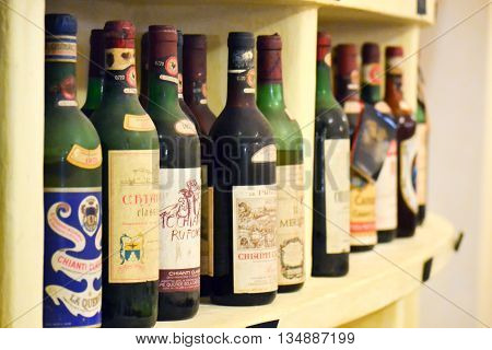 old expansive collection of italian wine bottles