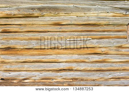Background texture pattern Log built barn cabin with lodge pine pole beams historic and rustic rural remote shelter