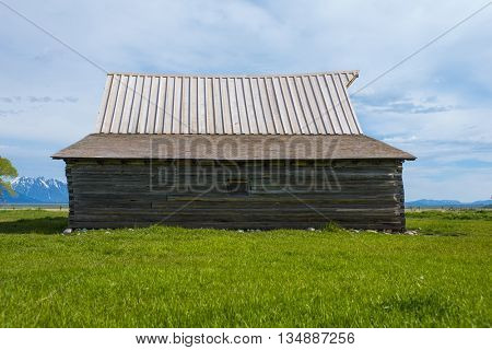 Log built barn cabin with lodge pine pole beams historic and rustic rural remote shelter