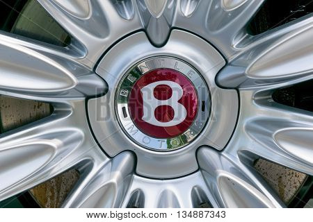 TURIN, ITALY - JUNE 13, 2015: Closeup of the Bentley logo on wheel