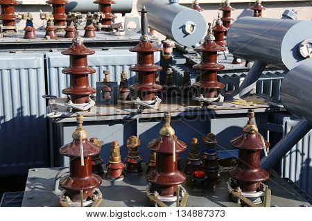Old Electric Voltage Transformers With The Ceramic Insulators In Landfills