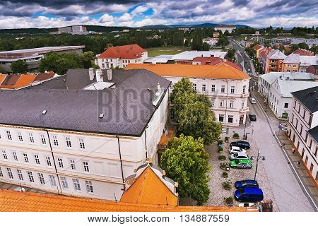 2016-06-18 Chomutov city Czech republic - northern view from the 'Mestska Vez' tower to the historical Chomutov town with 'Husovo Namesti' square football field and Gymnasium on the hill