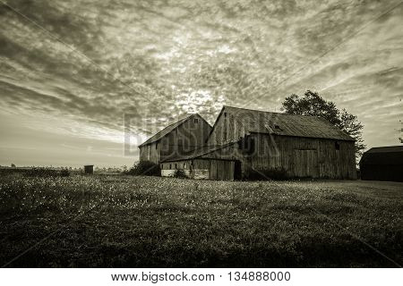 Vintage Farm Landscape. Black and white farm landscape in horizontal orientation with copy space.