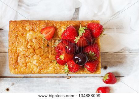 Fruitcake With Strawberry And Cherry Topping