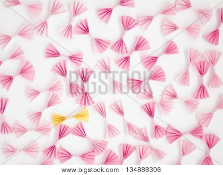 pink and yellow bows on a light background
