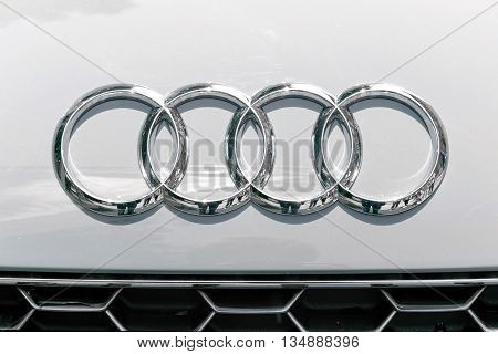 TURIN, ITALY - JUNE 13, 2015: Audi logo on a white car body