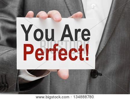 You Are Perfect. Card in business hand