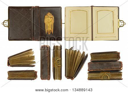 Different perspectives of vintage photo album (circa 1900) with buckle and brass engraved decoration isolated on white contains working paths