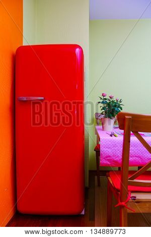 Retro-styled Red Refrigerator In The Kitchen Room
