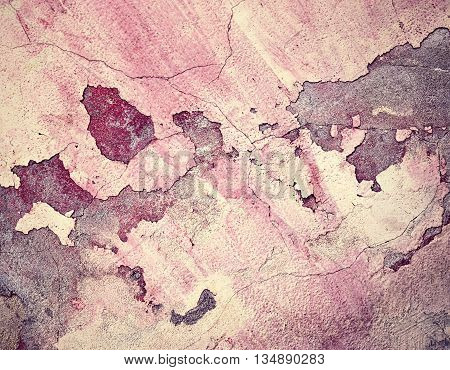abstract background old dingy burgundy cracked plaster wall