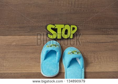 Knitted baby slippers, opposite the inscription