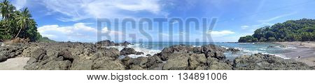 Montezuma Beach in Costa Rica on the Pacific coast. Panorama of several frames