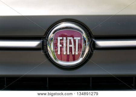 TURIN, ITALY - JUNE 9, 2016: New Fiat logo on the front of a 500 car model