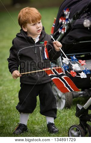 Oslo Norway - May 17 2010: National day in Norway. Norwegian boy at traditional celebration and parade on Karl Johans Gate street.