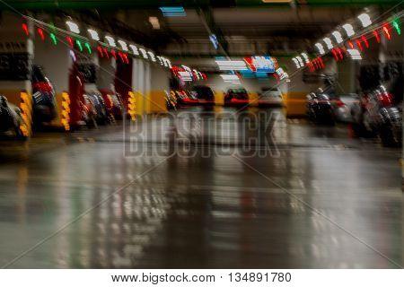Underground parking lot with cars, blur dark background