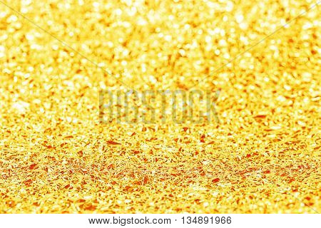 Shiny Yellow Gold Foil Texture For Background And Bokeh Shadow. Crease