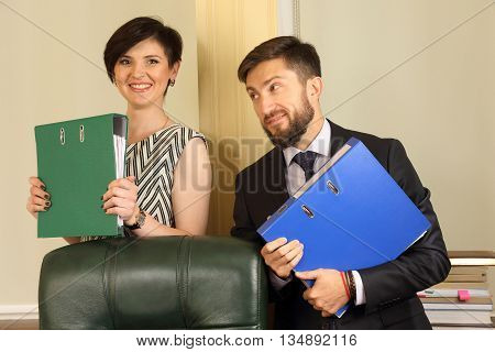 business partners in the office holding documents