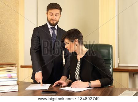 business partners in the office to discuss the documents