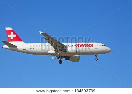 ZURICH - JULY 18: A-320 landing in Zurich airport after short haul flight on July 18, 2015 in Zurich, Switzerland. Zurich airport is home port for Swiss Air and one of the biggest european hubs.