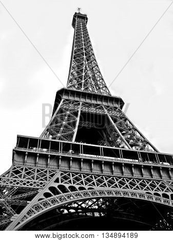 A black and white photo of the Eiffel Tower in Paris, France.