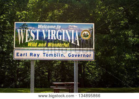 Huntington, West Virginia, USA - June 14, 2015: Welcome sign at the West Virginia visitors center at the Ohio and West Virginia border.