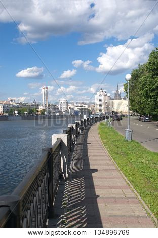 Moscow river and embankment in summer day, vertical view