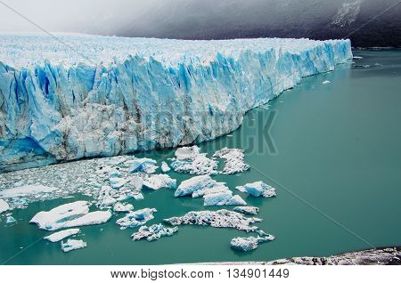 The blue ice of glacier Perito Moreno in Patagonia, Argentina