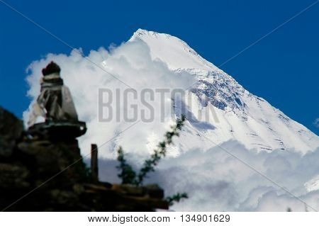 Dhaulagiri peak, behind a buddhist stupa near the monastery of Muktinath