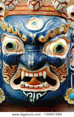 Blue mask of a demon, Nepal handcraft