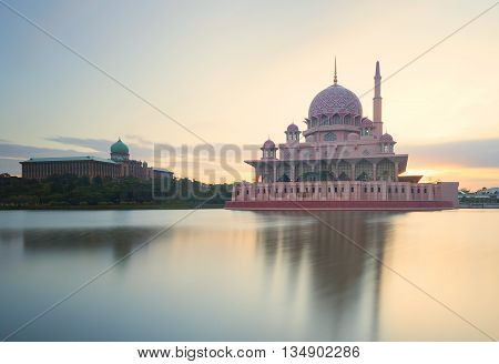 Long exposure shot of a mosque during sunrise.
