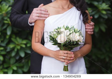 Cream and green bridal bouquet of roses and alstroemeria flowers