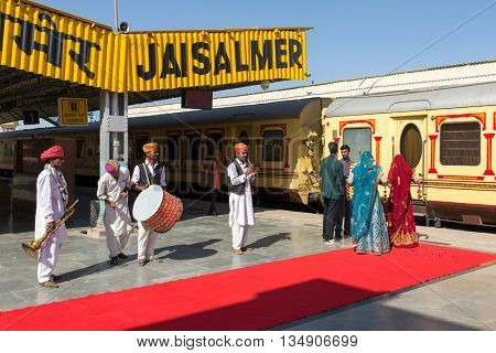 Jaisalmer, India - March 13, 2016: Musicians playing traditional rajasthani music for passangers of luxury train Palace on Wheels in Jaisalmer, India.