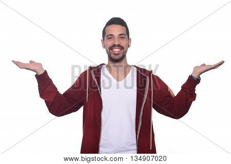 Potrait of young latin man offering something. Isolated white background.