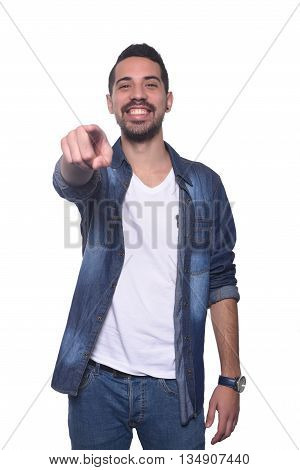 Portrait of young latin man pointing to camera. Isolated white background.