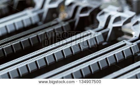 PCI-E socket on computer main board, closeup background