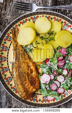 Fried Roach Served With Potatoes And Salad