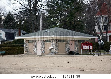 HARBOR SPRINGS, MICHIGAN / UNITED STATES - DECEMBER 24, 2015: The restrooms at the Zorn Park Beach are closed for the winter season.