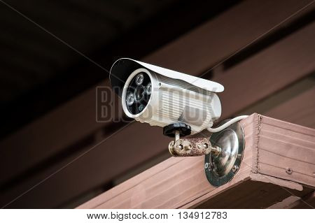 closed video circuit camera on wooden background