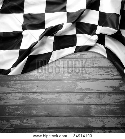 Checkered black and white flag on boards. Copy space