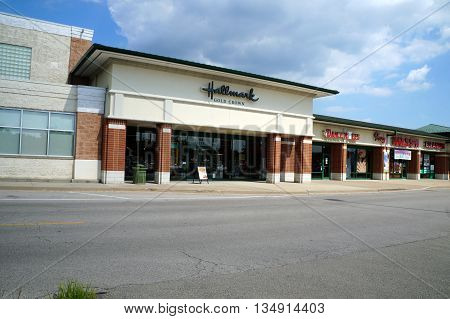NAPERVILLE, ILLINOIS / UNITED STATES - JULY 23, 2015:  One may purchase greeting cards and small gifts at the Hallmark Gold Crown store, in a Naperville strip mall.