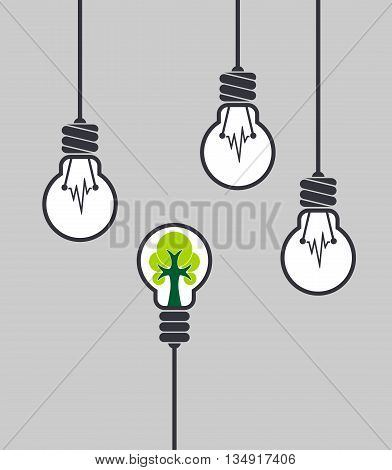 Lamp with tree inside different among the others. Ecological concept. Innovative concept