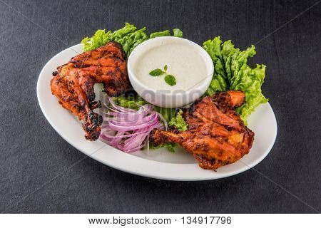 tandoori chicken leg, Tandoori Chicken , Indian spicy food, Delicious Tandoori chicken leg piece with Salad, India