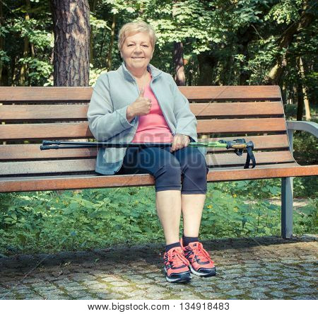 Vintage Photo, Senior Woman Resting After Nordic Walking And Showing Thumbs Up, Sporty Lifestyles