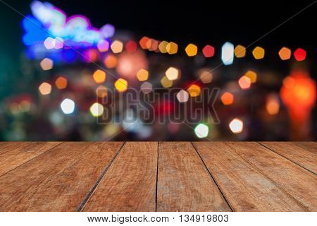 Perspective top wooden with abstract blurred lights in Loy Krathong festival