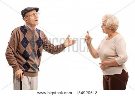 Studio shot of an elderly couple arguing with each other isolated on white background