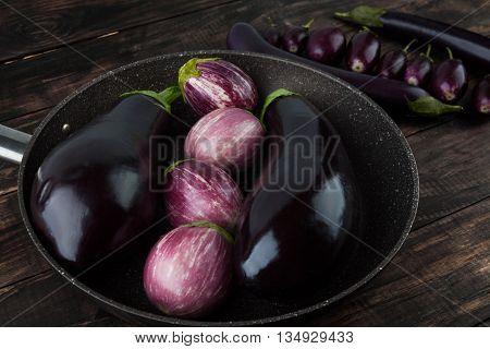 Eggplant Varieties On Wooden Table
