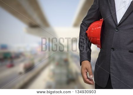 Engineer helmet for workers security over blurred construction in background