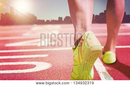 Close up of athletic feet against a white background against composite image of race track
