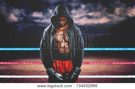 Boxer posing after failure against dark cloudy sky